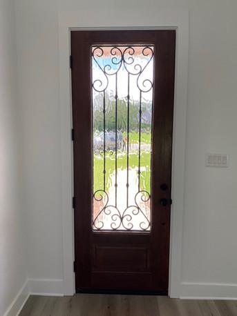 Mahogany wood door with metal accent