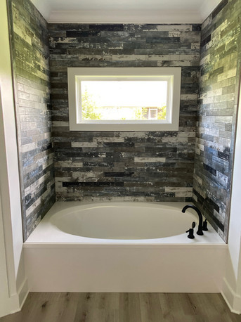 Master bath with tile accent wall