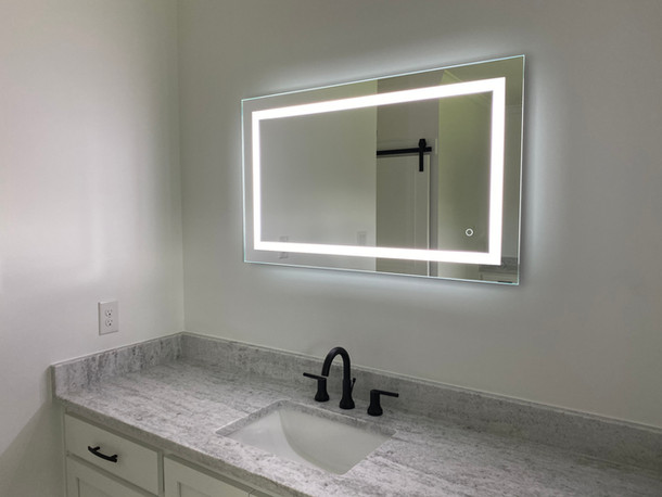 Lighted mirror in jack and jill bathroom