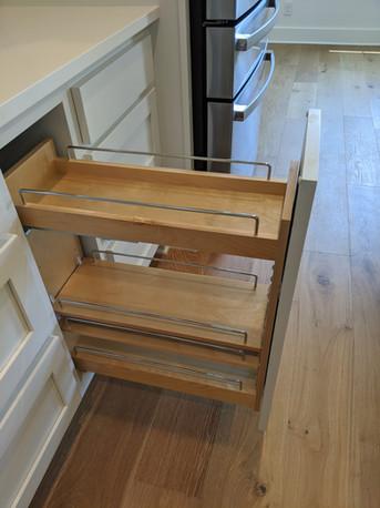 Spice rack and utensil holder in kitchen