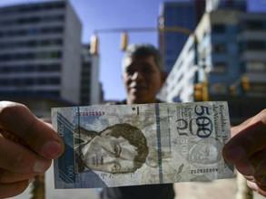 Los venezolanos se preparan con mucha incertidumbre para el nuevo cambios de moneda (video)
