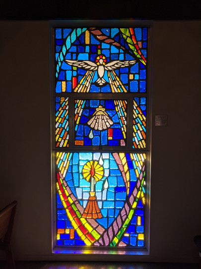 Baptism window located in our Chapel.