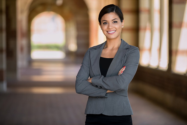 Confident successful smiling business woman executive with folded arms .jpg