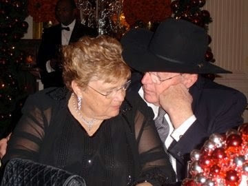 Mom and Dad at the White House Christmas party 2006