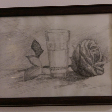 Glass cup and rose