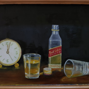 A bottle of whiskey and glasses