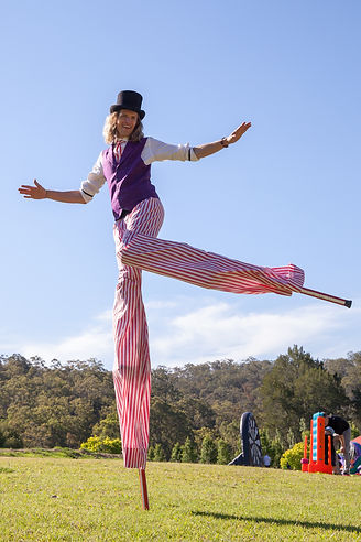 Dancing stilt walker