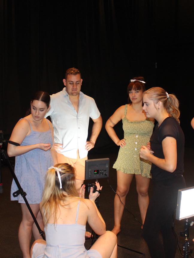 In Your Hands Crew Discussing Lighting