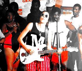 Kathy Rey AKA Aja playing with Riske. All female Haitian Compa Band