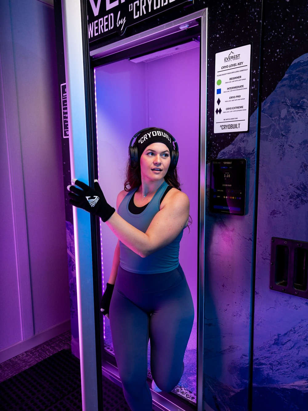 girl, walking out, cryotherapy chamber, headband, gloves, purple tint