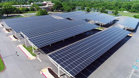 drone view solar panels in parking roof.
