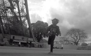 Makai chasing pigeons around the plaza of the Eiffel Tower