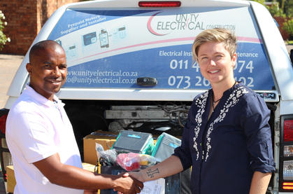 Lauren presenting Manamane with all of his sponsored machinery.