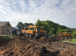 tractor helping muck shift