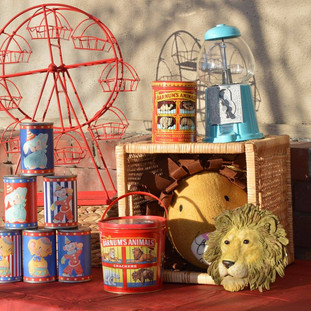 Lion Head Bust ($1) Small Animal Cracker Tin ($3) Large Animal Cracker Tin ($4) Blue Gumball Machine w/ gumballs ($15) Tin Can Game ($10) Ferris Wheel ($15)