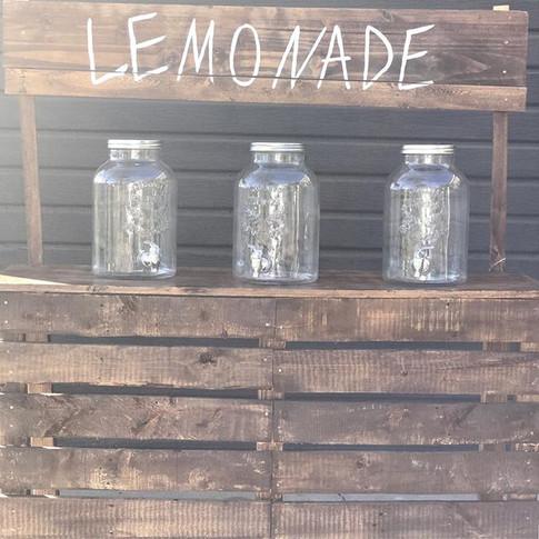 Rustic Lemonade Stand with 3 mason jar beverage dispensers.