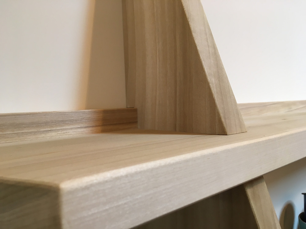 A close-up of a hand cut tapered half lap housing dado joint.