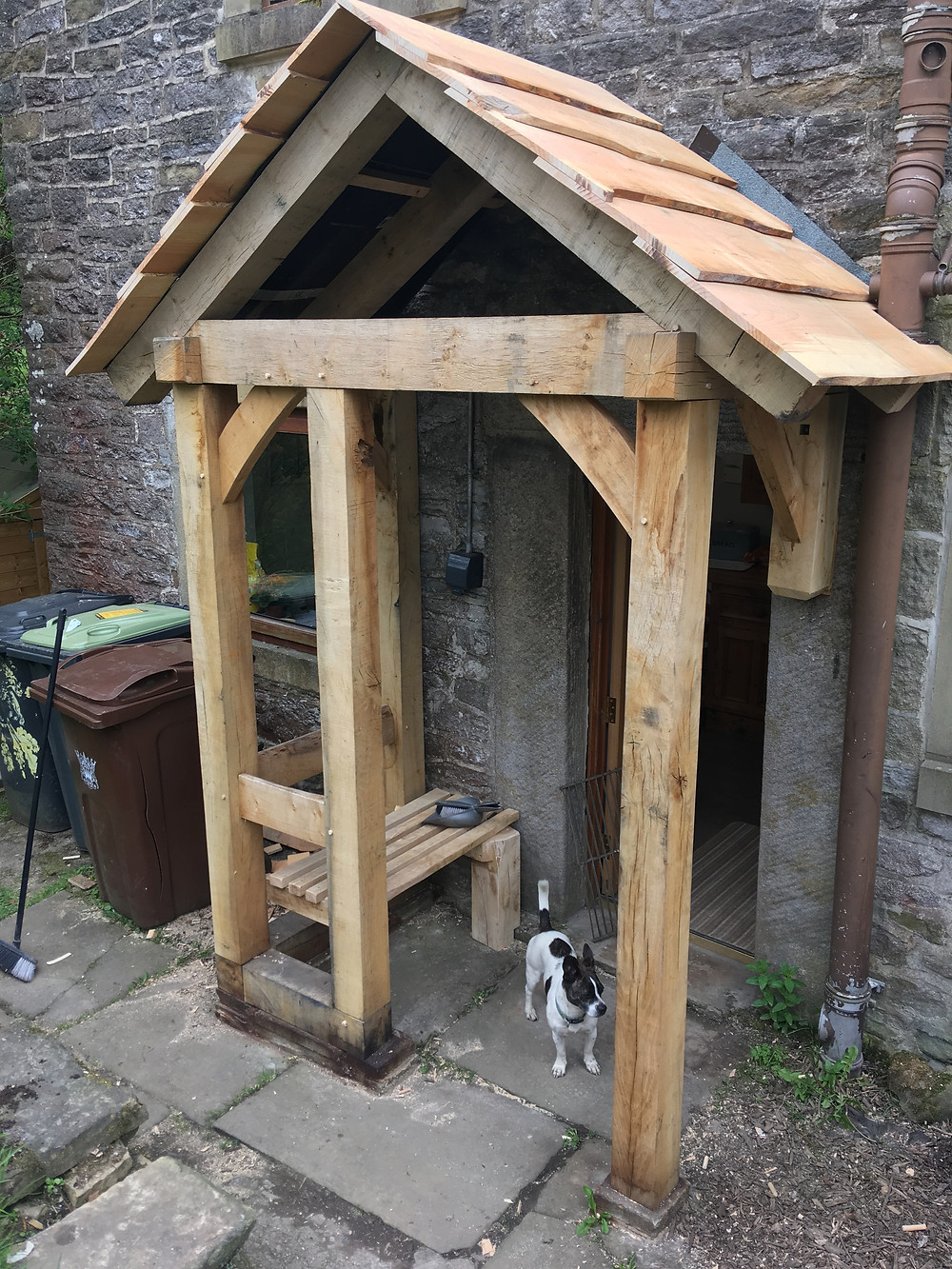 Cedar roof going on - dog for scale!