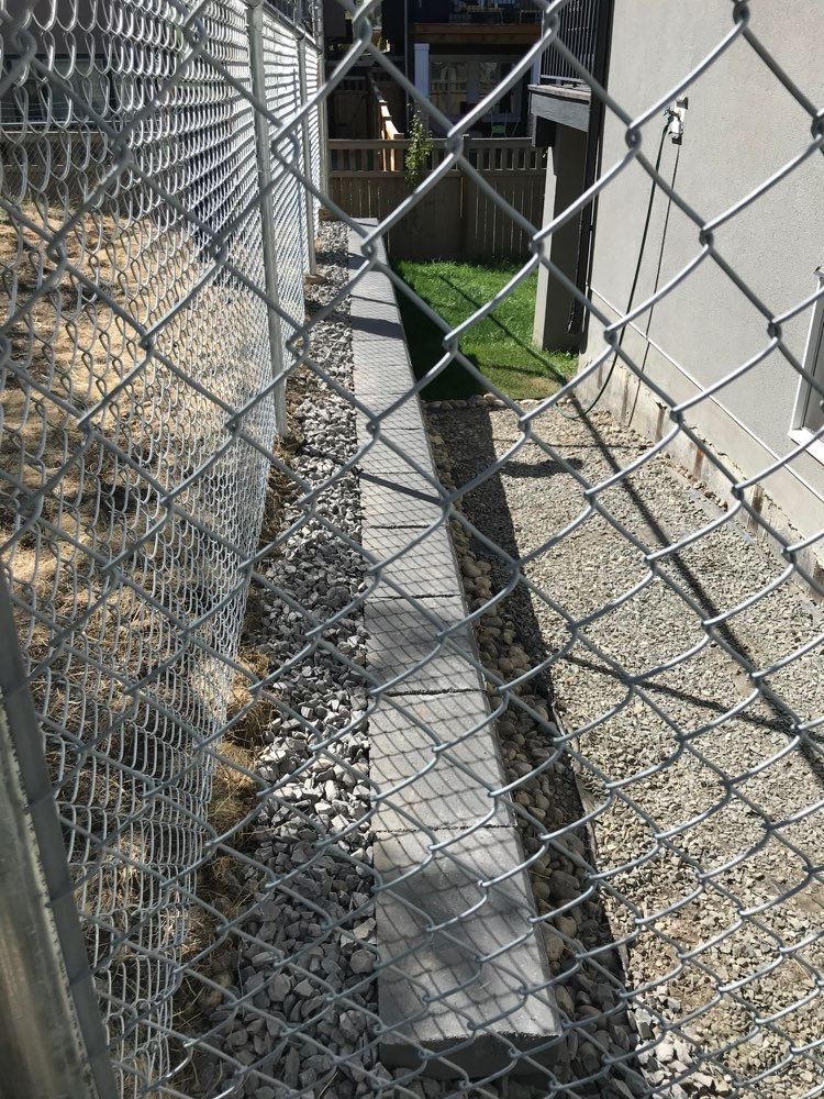 Chainlink Fencing Replacement & Decorative Rock