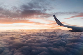 white-airliner-wing-on-top-of-sea-clouds