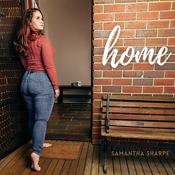 """Album cover for """"Home"""", featuring Samantha Sharpe walking through her own front door!"""