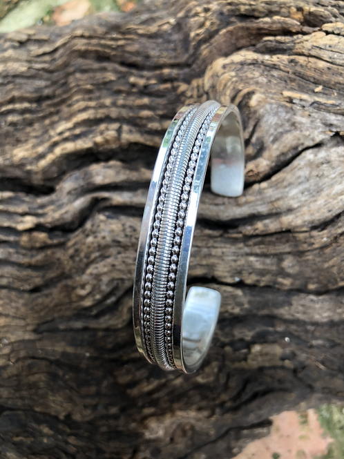Navajo sterling silver cuff with fine bead work, signed.