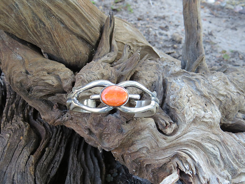 Navajo hand stamped silver work and orange spiny oyster cuff, signed SM_U