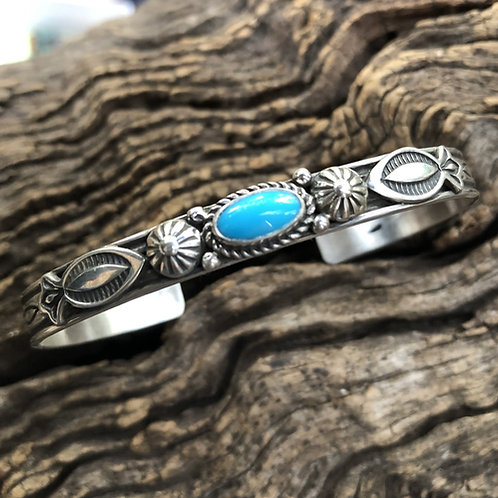 Navajo intricate sterling silver design cuff with turquoise stone.