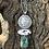 Thumbnail: Lady Liberty 1886 coin pendant with White Buffalo and Royston Turquoise stones.
