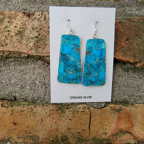 Navajo turquoise slab earrings set into silver mounting by Veronica Tortalita