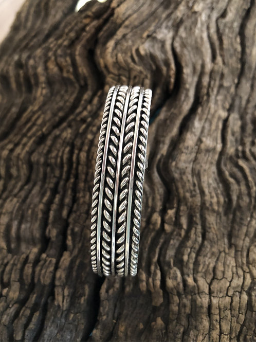 Navajo sterling silver cuff with cut design work by Tom Hawk, signed