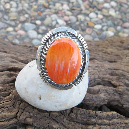 Sold- Navajo orange spiny oyster shell ring set in sterling silver. Size 7.25