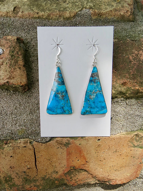 Turquoise slab earrings set into silver mounting by Veronica Tortalita