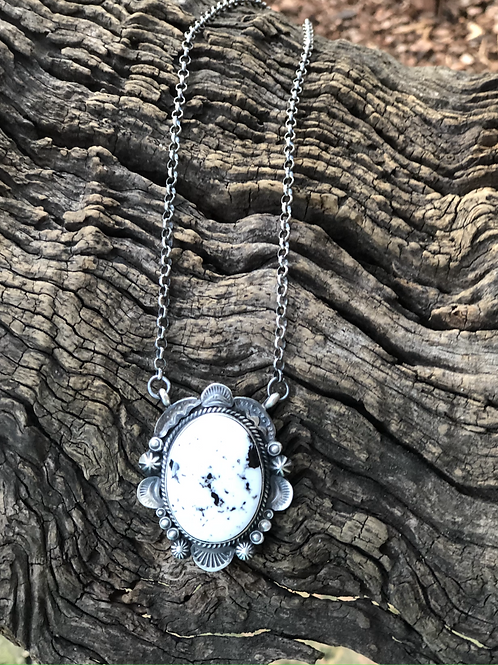 White Buffalo necklace with stamp work around bezel by Gilbert Tom, Navajo