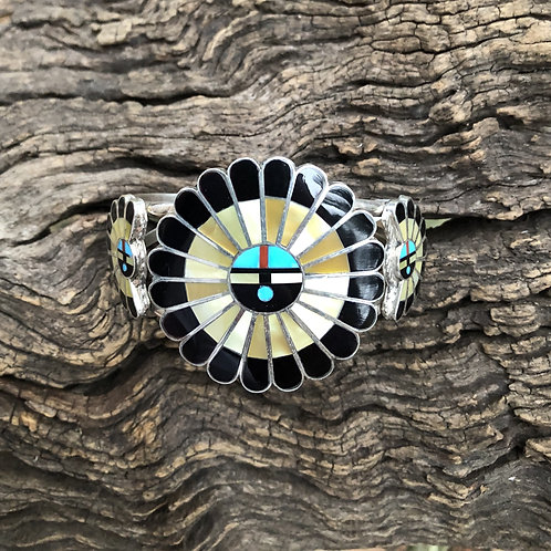 Zuni sunface bracelet with gold mother of pearl, black onyx and turquoise inlay.