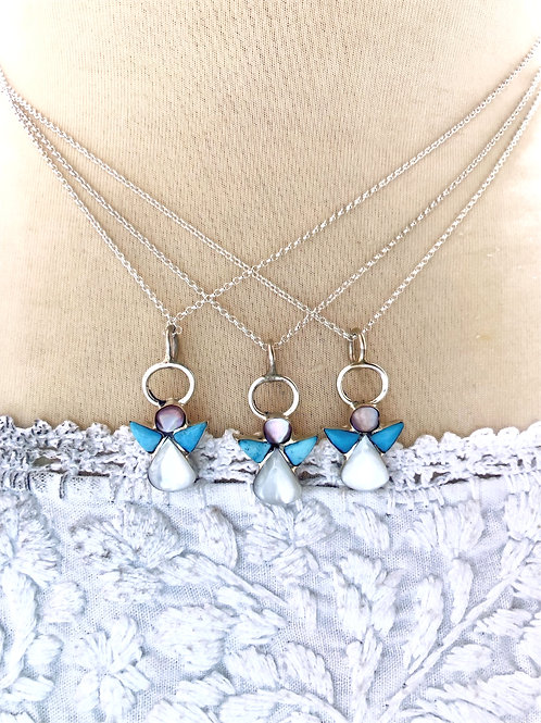 """Sold- Turquoise and mother of pearl set into sterling silver on 18"""" chain. $28."""