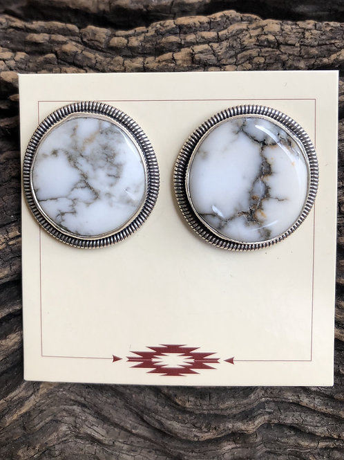 White Buffalo round stud earrings with sterling silver design work.