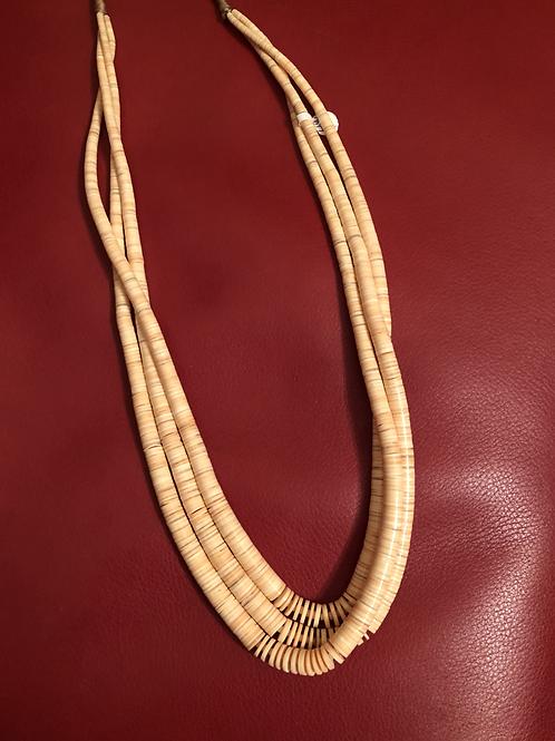 Beautiful melon shell wafer cut three strand heshi necklace on pueblo wrap.