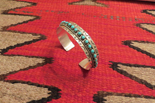 SOLD: Zuni cuff with turquoise stones signed by artist $135