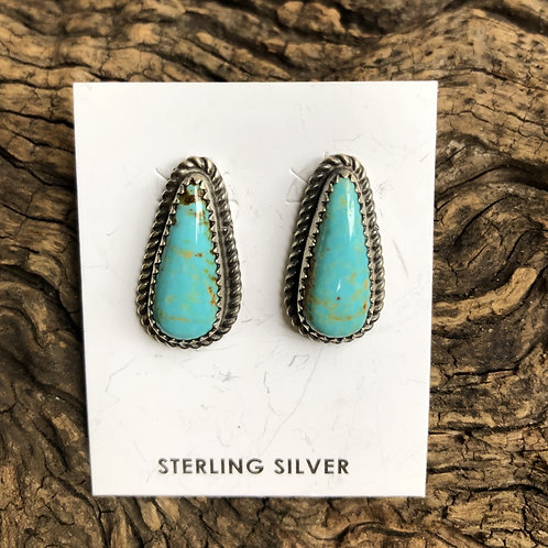 Turquoise stud earrings set into sterling silver by Virginia Becenti, Navajo.