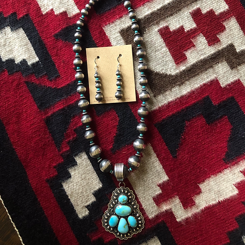 Sonoran Gold Turquoise pendant on graduated Navajo pearls necklace.