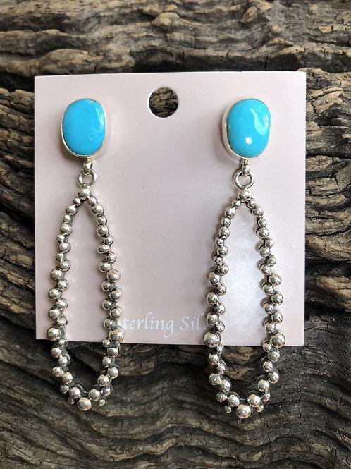 Turquoise stud earrings with intricate sterling silver hoop dangles.