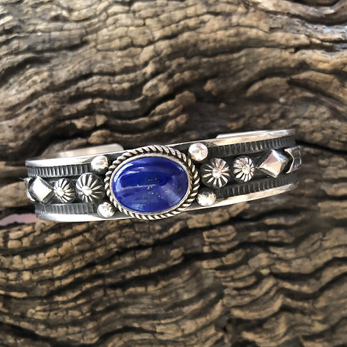 Navajo sterling silver cuff with intricate design and lapis stone, signed HBM