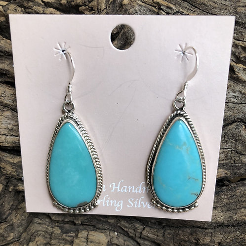 Turquoise dangles set into sterling silver with french wires, by S. McCarthy.