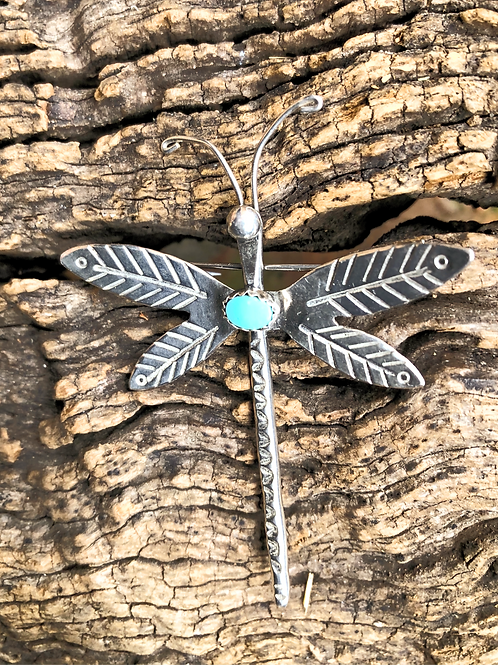 Sterling silver hand stamped dragonfly with single turquoise stone, signed.