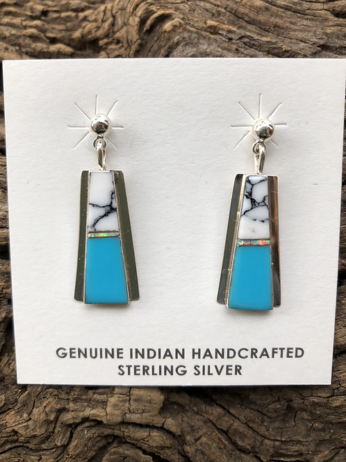 White Buffalo and turquoise inlay earrings set into sterling silver.