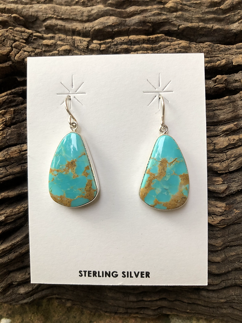 Turquoise dangles set into sterling silver on french wires.