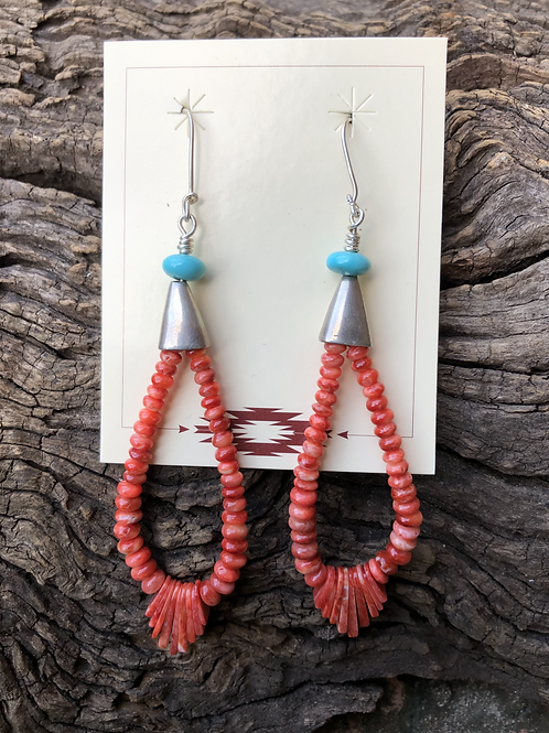 Hand cut orange spiny rondel cut beads with turquoise and silver dangles.
