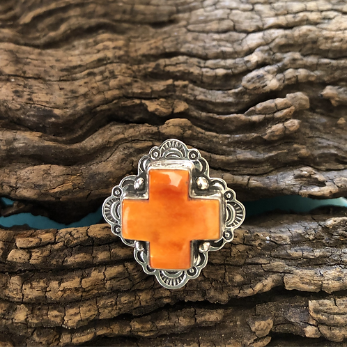 Sterling silver cross ring with orange spiny stone, adjustable.