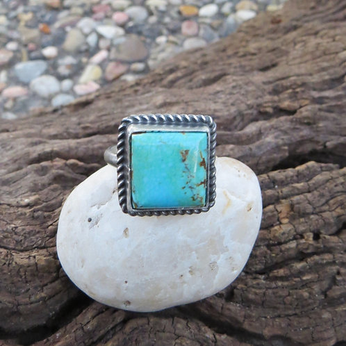 Sold- Navajo turquoise ring with silver roping around bezel. Size 7.5 $80.